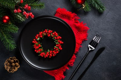 Christmas table setting on black top view