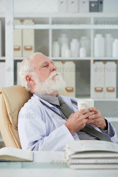 Tired doctor having break