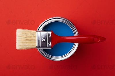 Can with Blue Paint with Red Brush.