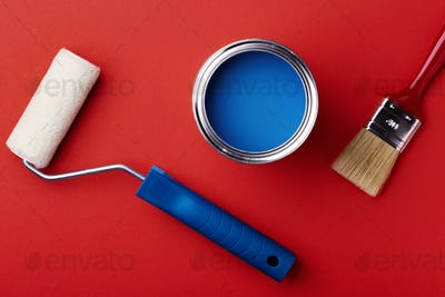 Can of Blue Paint with Brush and Paint Roller.
