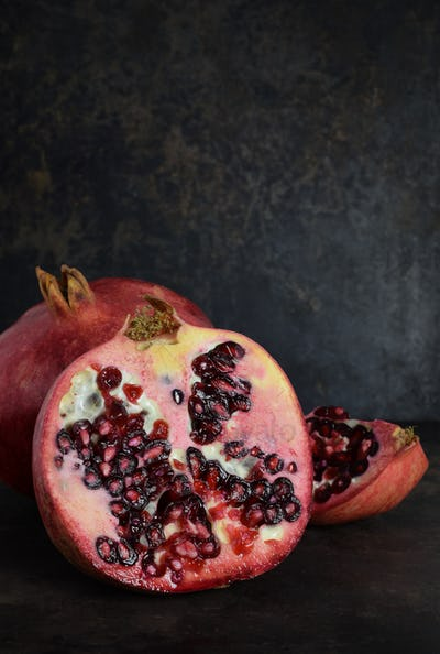 Pomegranate Fruits on a Dark Background