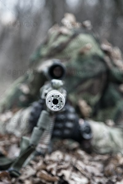 Sniper shooting from masked position on ground