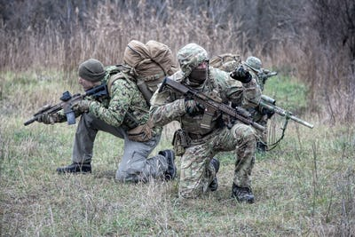 Military army soldiers tactical teamwork in forest