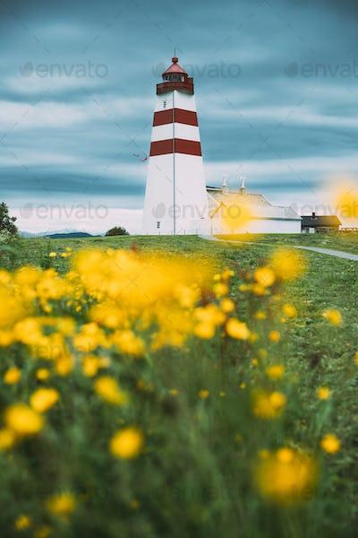 Alnesgard, Godoya, Norway. Old Alnes Lighthouse In Summer Day In Godoy Island Near Alesund Town