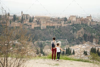 Mother and little daughter looking at the Alhambra