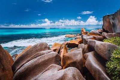 Beautifully shaped granite boulders on Grand Anse beach, La Digue island, Seychelles
