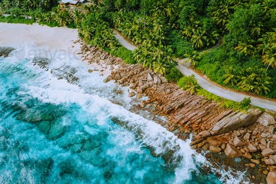 Aerial photo of coastal road along paradise tropical rocky beach at Seychelles. Summer vacation