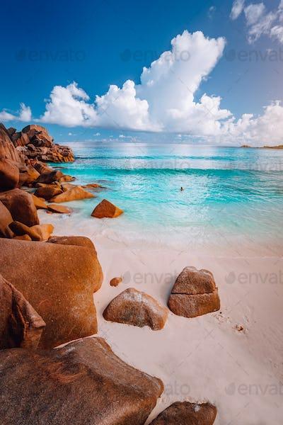 Idyllic scenery sea cloudscape of Grand Anse beach in La Digue island, Seychelles. Nature background