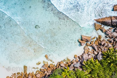 Anse Cocos beach tropical island La Digue Seychelles. Drone aerial view bird-eye perspective at the