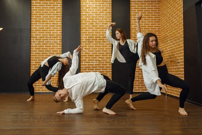 Contemporary dance group poses in studio