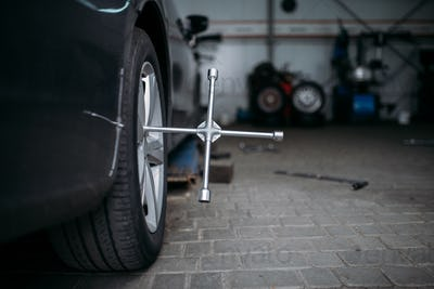 Car wheel with wrench, tire service concept