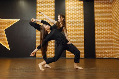 Two female contemporary dance performers