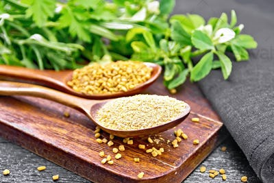 Fenugreek in two spoons with herbs on board