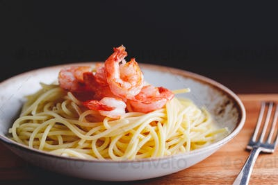 Fried shrimps on the pasta.