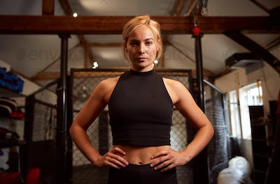 Portrait Of Female Mixed Martial Arts Fighter Training In Gym