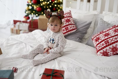 Portrait of charming baby in Christmas morning