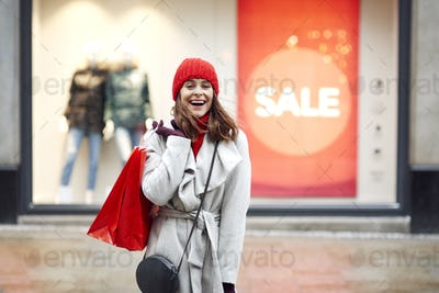 Beautiful woman with full of shopping bags