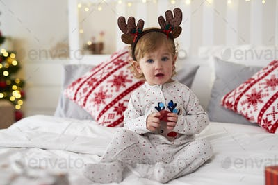 Portrait of charming baby with Christmas gift