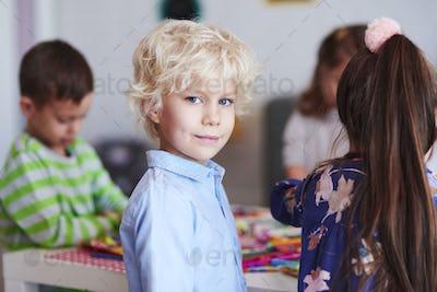 Happy boy in blue shirt