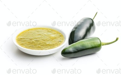 Green jalapeno peppers and tabasco sauce.