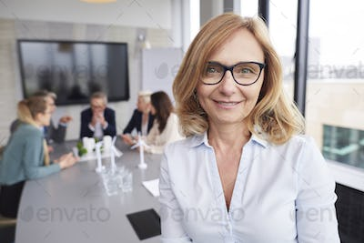 Mature businesswoman leading during business meeting