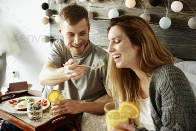 Man sharing breakfast with woman