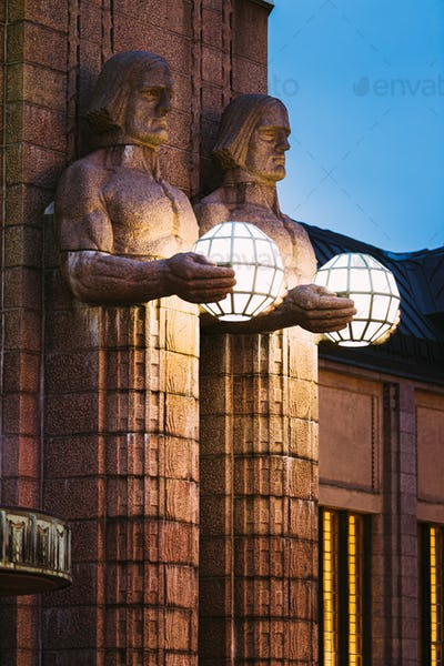 Helsinki, Finland. Night View Of Two Pairs Of Statues Holding The Spherical Lamps On Entrance To