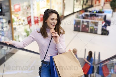 Young woman with credit card and full shopping bags