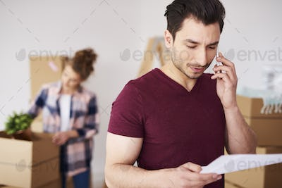 Man using cell phone in his new home