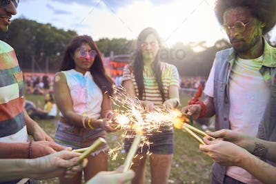 Friends having fun with sparkler at the summer festival