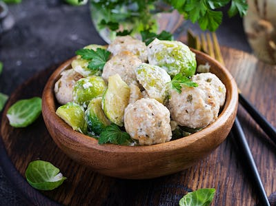 Brussels sprouts roasted with chicken meatballs and onions in a creamy sauce.