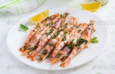 Grilled wild Argentinian red shrimps/prawns with parsley, oil, garlic and lemon.