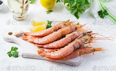 Raw wild Argentinian red shrimps/prawns  and ingredients for cooking.