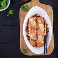 Baked salmon fillet with fresh vegetables salad. Healthy food. Ketogenic/paleo diet