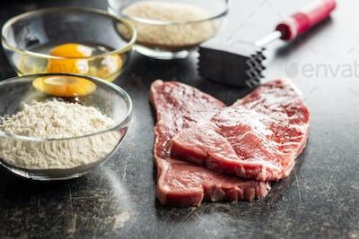 Raw veal schnitzel.