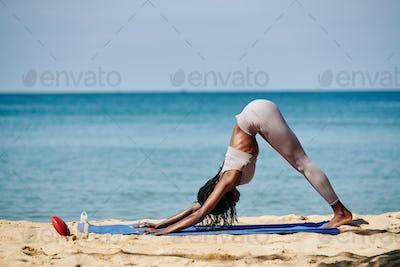 Woman doing downward facing dog
