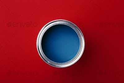 Can of Classic Blue Paint on Red Background.