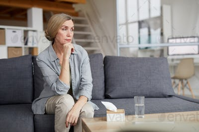 Pensive Mature Woman at Home