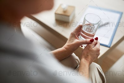 Therapy Patient Holding Glass of Water