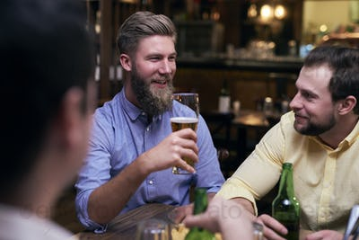 Male friends spending time together in the pub