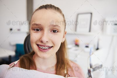 Portrait of smiling teenage girl with braces