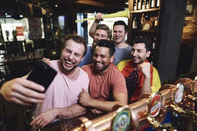 Group of male friends making a selfie