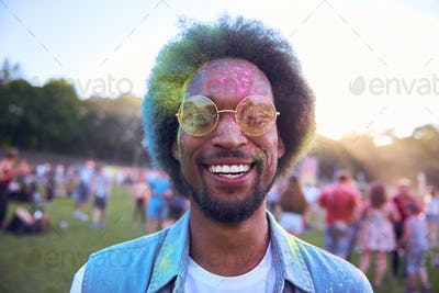 Smiling African man in holi colors