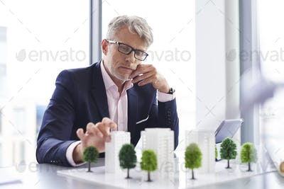 Busy businessman thinking about new solution