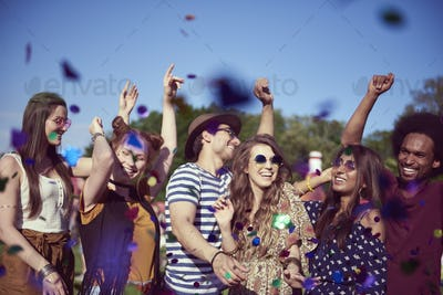 Group of friends dancing in confetti