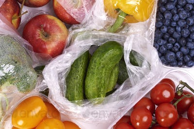 Plastic bags of fruits and vegetables