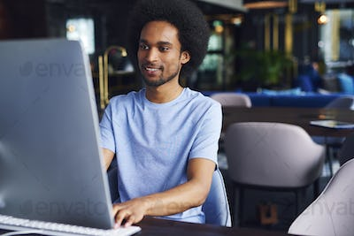 African man working on computer in the office