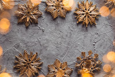 New Year's straw toys, on a gray concrete background. Christmas card