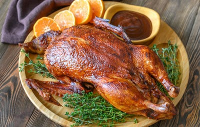 Baked duck on wooden tray