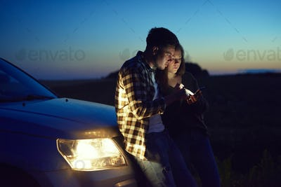 Young couple choosing the best road